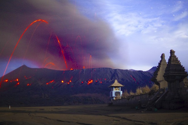 Strombolic activity at Mount Bromo, 2011, with Hindu temple in the foreground.  Image: Tom Pfeiffer